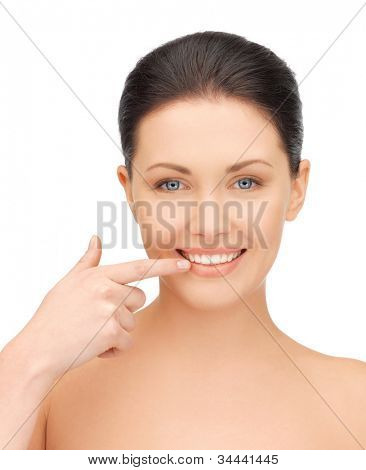 picture of beautiful woman pointing to teeth