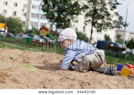 Child Crawling In Sandbox
