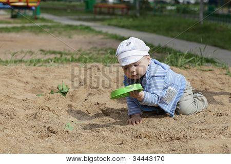Child Holding Toy Sieve