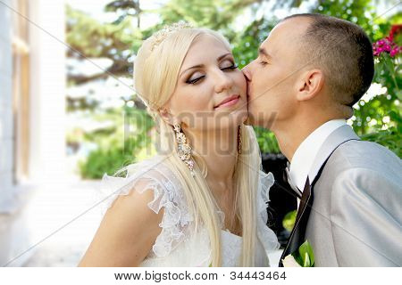 Kissing Wedding Couple In Spring