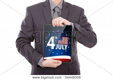 Business man with touch screen device  show American Flag for Independence Day