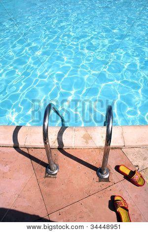Flip-flops Near The Swimming Pool