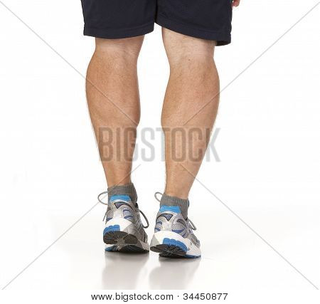 Runner Stretching Calf Muscles Of Legs