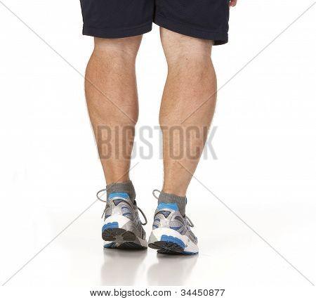 Runner Stretching Calf Muscles Of Legs