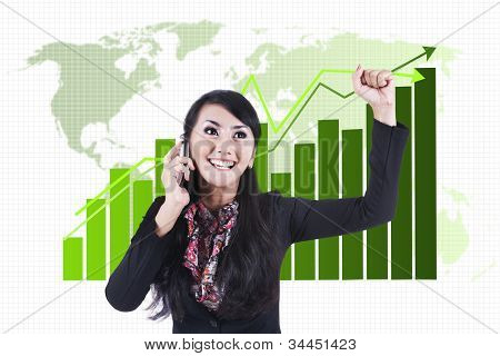 Successful Businesswoman With Business Chart