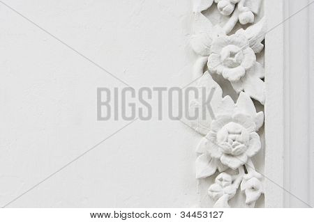 White flower stucco bas-relief