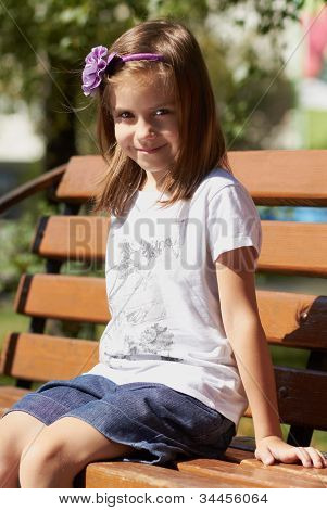 Cute Little Girl Outdoors In Summer