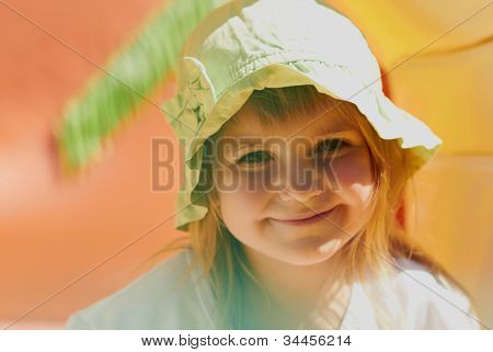 Cute Little Girl Outdoors In A Hat