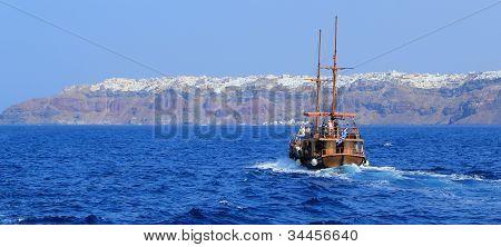 Tourists Boat Going To Oia, Santorini, Greece