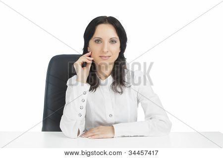 Lovely Businesswoman Wearing White Sitting In Chair While Hand Folded