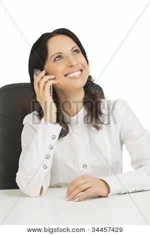Lovely Businesswoman Wearing White Sitting In Chair While Takling On Mobile