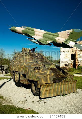 Military Vehicle And Mig 21 Airplane