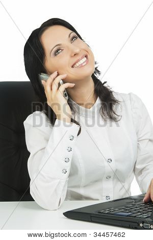 Lovely Businesswoman Wearing White Sitting With Laptop And  Takling On Mobile
