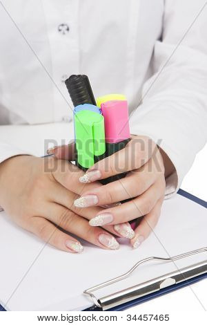 Female Hands Holding Colorful Markers