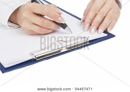 Female Hands Writing On Paper Sheet