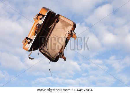 Empty Suitcase On Sky Background