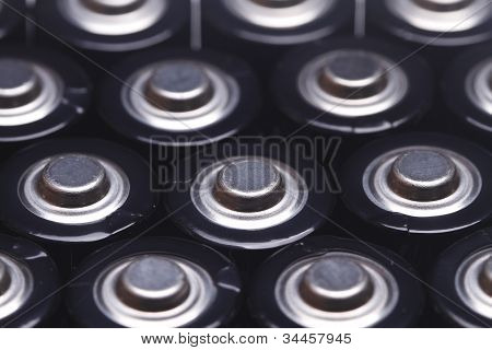 close up the top of AA battery,color on black