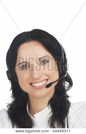 Closeup Portrait Of Young Smiling Brunette Call-center Customer's Support Operator With Headset Sitt