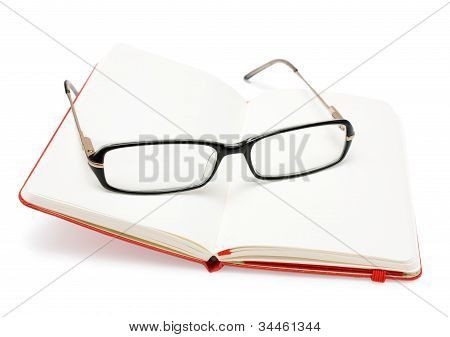 Red Open Notebook And Glasses Isolated On White