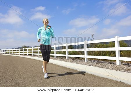 Female Jogger running outdoors (Lots of copy space)