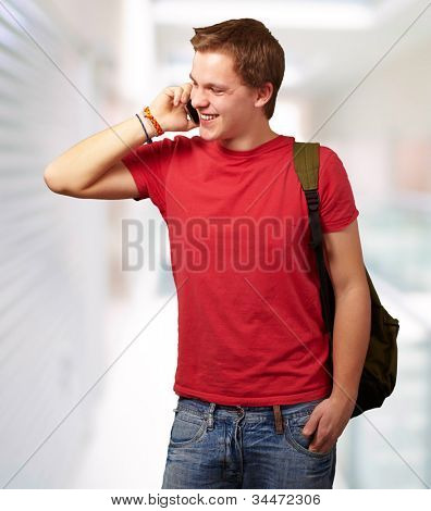 portrait of a young man talking on a mobile at a modern building