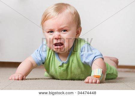 Toddler On The Ground Crying