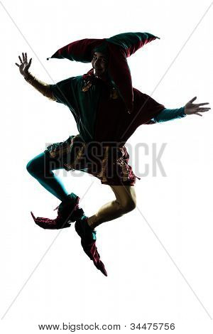 one caucasian man in jester costume jumping silhouette in studio isolated on white background