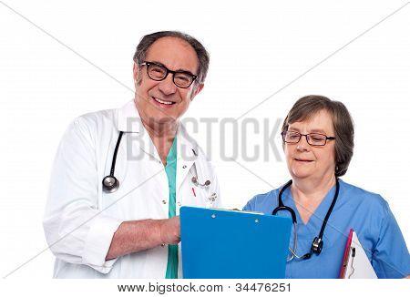 Senior Doctors Reading Medical Report