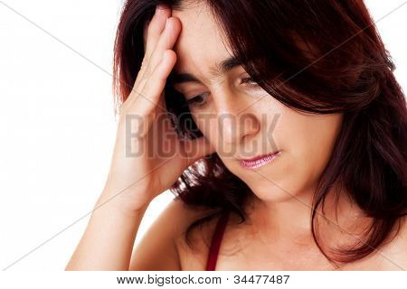 Close-up portrait of a stressed hispanic woman suffering depression or a strong headache isolated on white