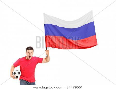An euphoric fan holding a ball and waving a russian flag isolated on white background