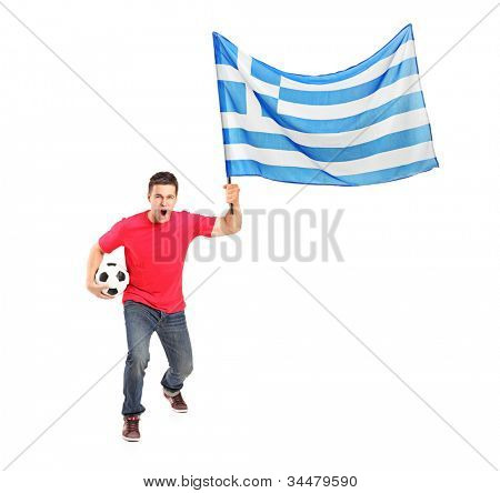 Full length portrait of an euphoric fan holding a ball and flag of Greece isolated on white background
