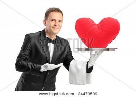 A butler holding a tray with a red heart shape object on it isolated on white background