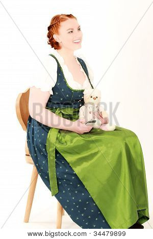 Woman in traditional dress with teddy bears