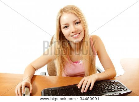 teen girl with internet dependence with keyboard looking at camera with interest like in monitor, isolated on white