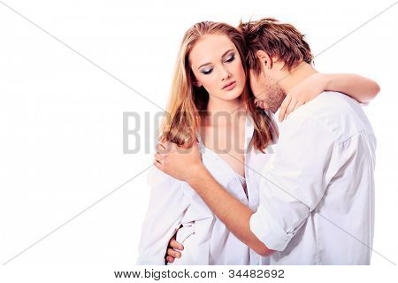 Shot of a passionate young people in love. Isolated over white.