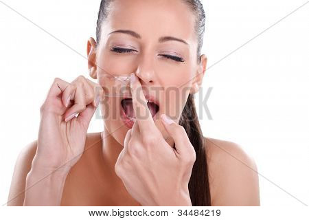 Beautician depilating, young woman getting waxing mustache