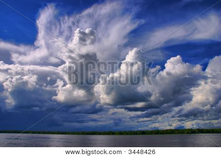 Cloudy Skies Over The River