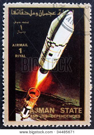 Postage stamp Ajman 1973 Rocket in Space