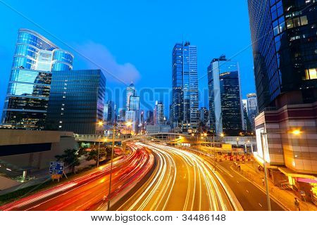 Modern urban landscape and the bustling streets in the evening