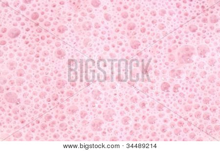 Macro pink foam bubbles texture of the background