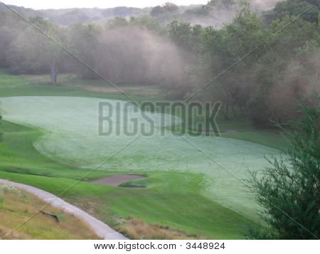 Mist Over A Fairway Just After Sunrise