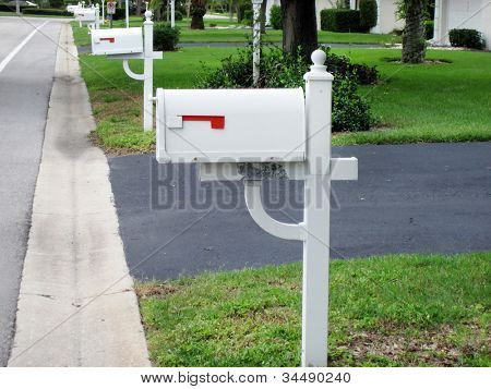 an image of white mailboxes in a row