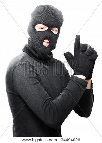Male Criminal In Mask Making A Hand Gun Gesture