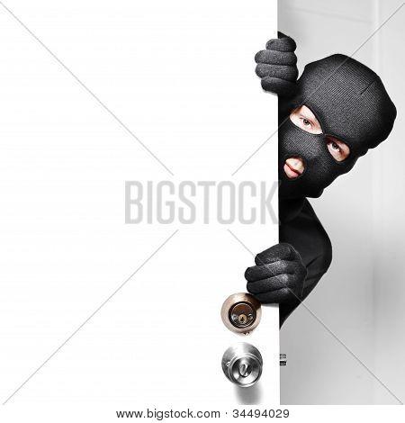 Home Burglar Opening House Door With Copyspace