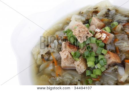 diet food : vegetable soup with bread  crackers in white bowl isolated over white background