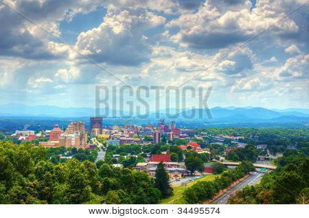 Asheville, North Carolina skyline nestled in the Blue Ridge Mountains.