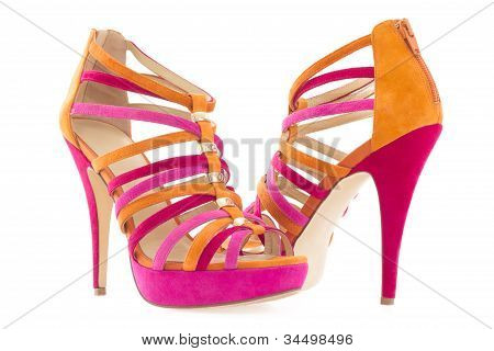 Pare Of Pink And Orange Shoes Isolated On White Background  .