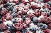 A Berry Mix In Sugar From Frozen Raspberries And Blueberries. A Frozen Berries With Sugar.  A Sweet poster
