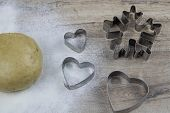 Preparation Of Ginger Biscuits. A Metal Form In The Form Of Gingerbread Man For Cutting Figured Cook poster