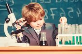 Chemical Analysis. Toddler Genius Baby. Boy Use Microscope And Test Tubes In School Classroom. Scien poster